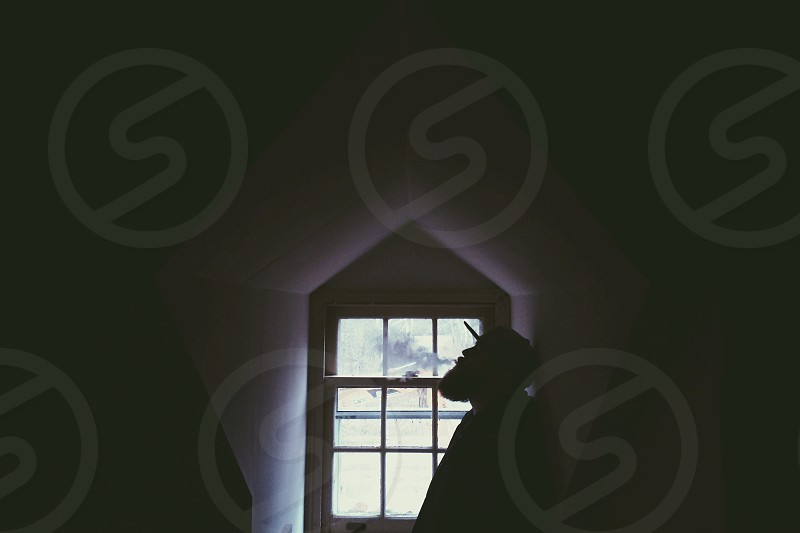 man sitting by the window photo photo