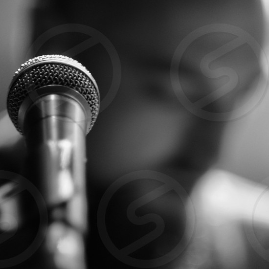 man near microphone stand photo