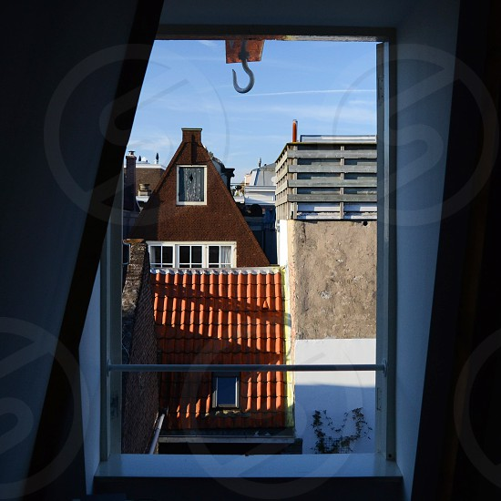 Looking through a canal house window at the interior courtyard and roof lines. photo