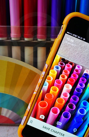 Taking a picture of coloring markers on Scriba photo