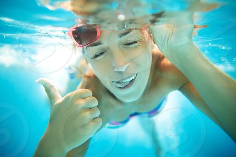 Underwater girl women happy joy smile  photo