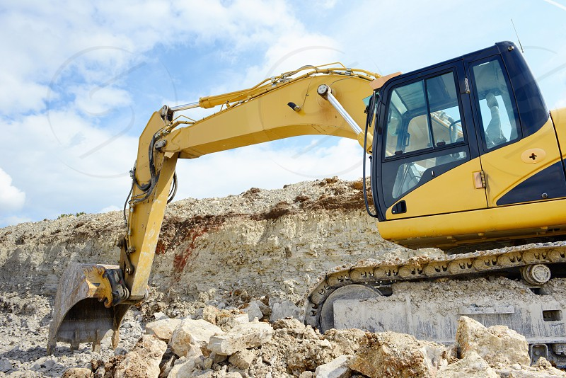 limestone quarry with earth mover. mining industry. photo