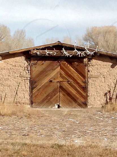 Barn door barn antlers Colorado mountains wooden door photo