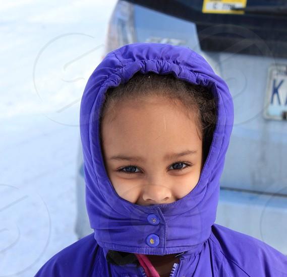 toddler's girl wearing purple jacket photo