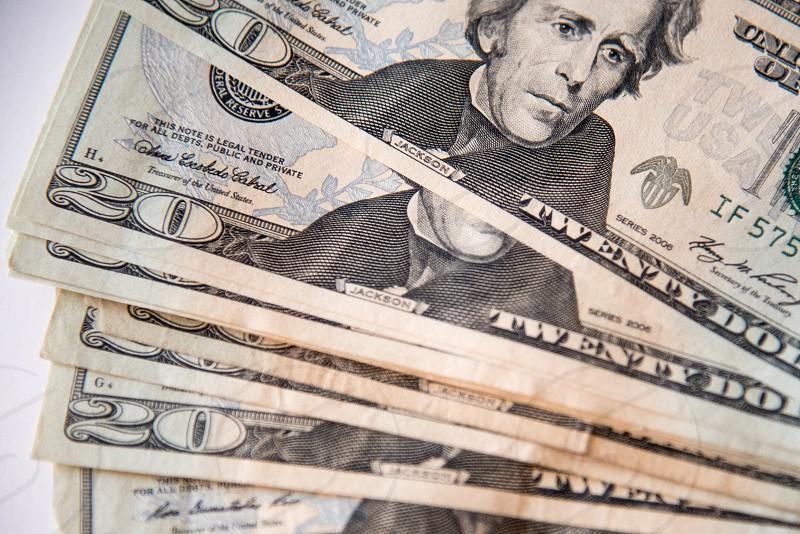 Used twenty dollar bills fanned. photo