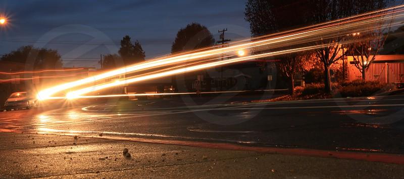 Headlight trails night photo single car idea taking you there. photo
