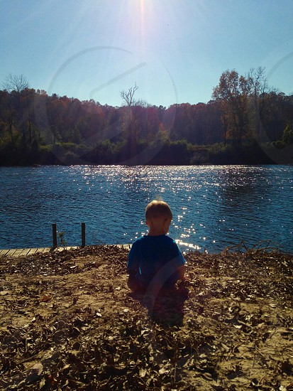 Boy enjoying the beauty of nature.  photo
