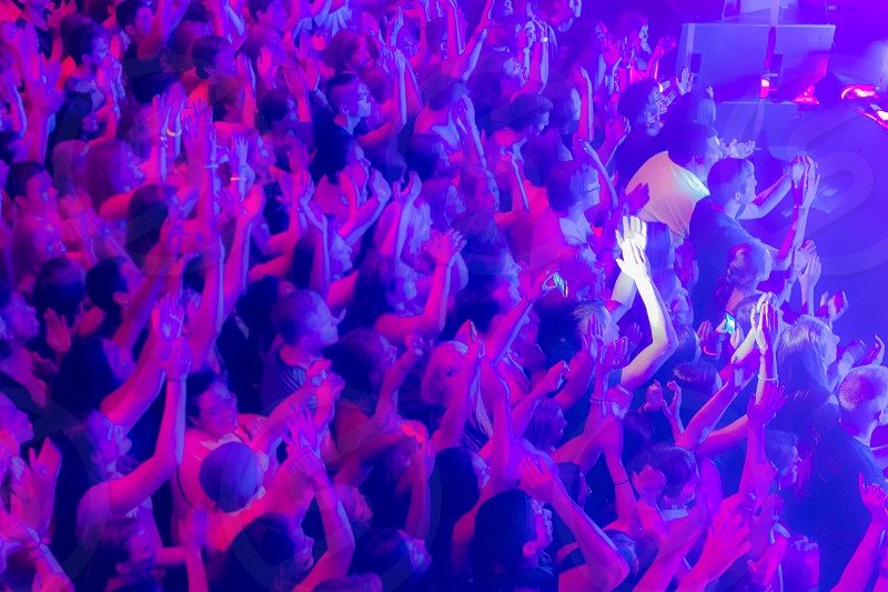 A concert crowd with motion blue photo