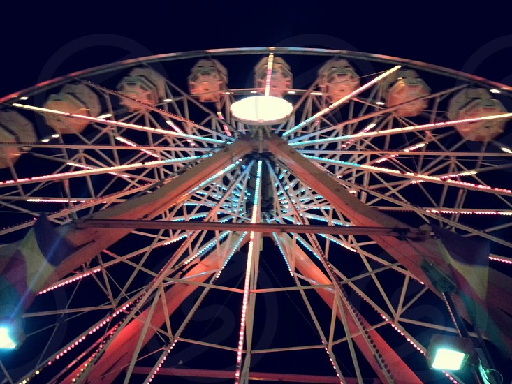 ferris wheel at night time low angle photography photo