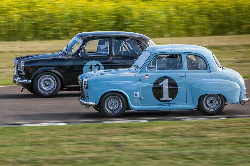 GOODWOOD WEST SUSSEX/UK - SEPTEMBER 14 : Vintage Racing at Goodwood at Goodwood on September 14 2012. Two unidentified people photo