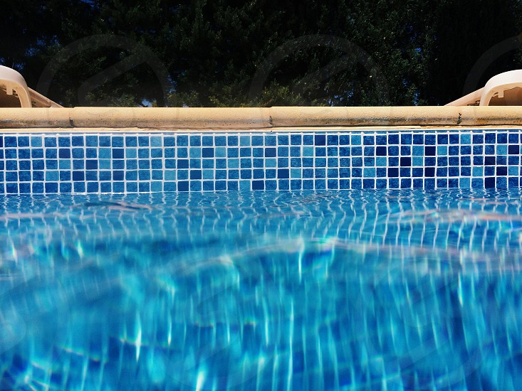 blue tile wall of swimming pool photo