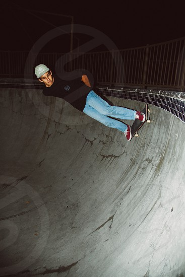 man in black t shirt skating on skating ramp photo