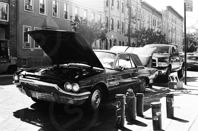 Car roadtrip stuck mustang old car vintage black and white brooklyn new york nyc 35mm garage fixing mechanics hood clean day light natural photo