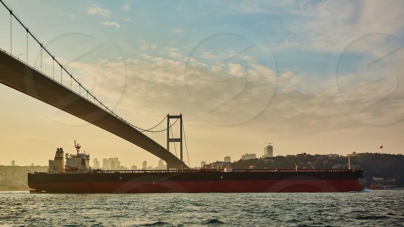 Turkey Istanbul Bosphorus Channel Bosphorus Bridge an cargo ship under the Bridge photo