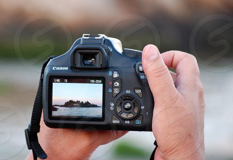 person using a canon digital d s l r camera photo