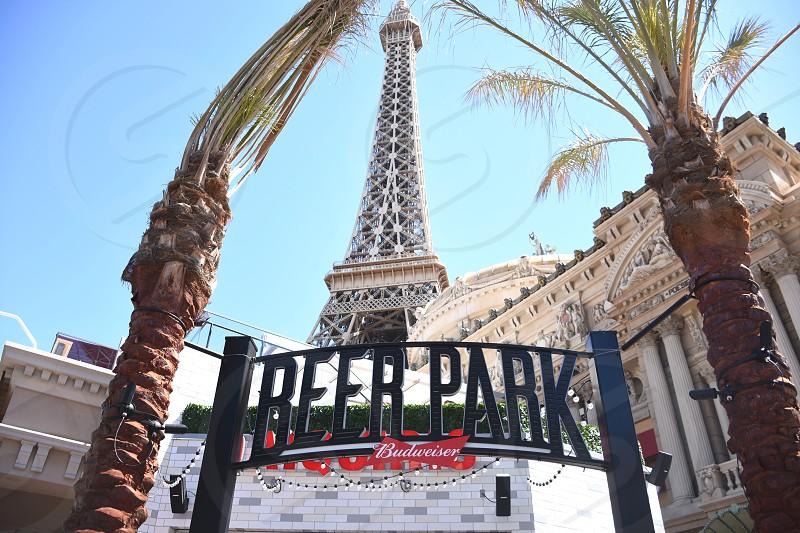 beer park signage under eiffel tower photo