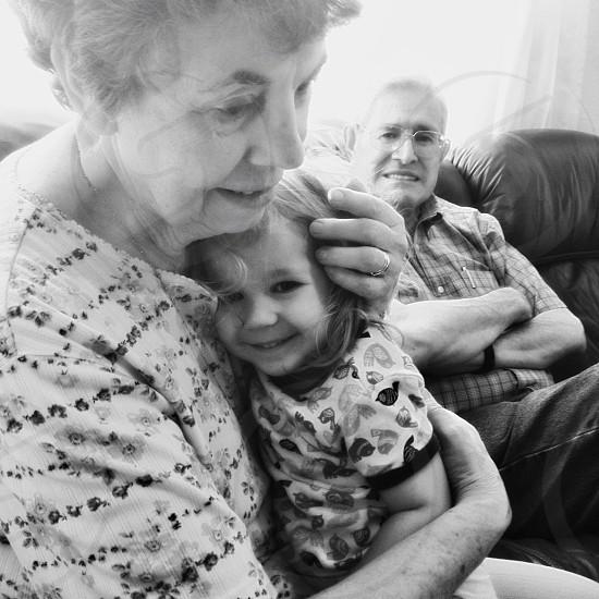 woman holding baby girl photo