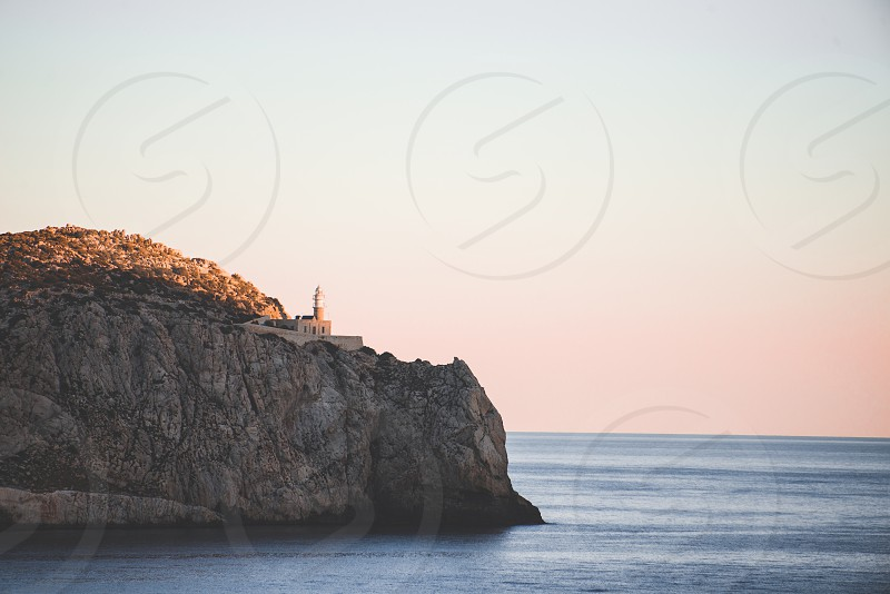 Lighthouse on a cliff around Mallorca Spain photo