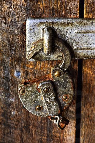 Rusty old Lock on barn door photo