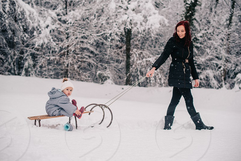 A mother and her child in the snow. photo