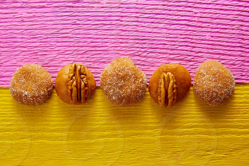 Cajeta caramel Mexican candy sweets with sugar and pecan nuts in a row photo