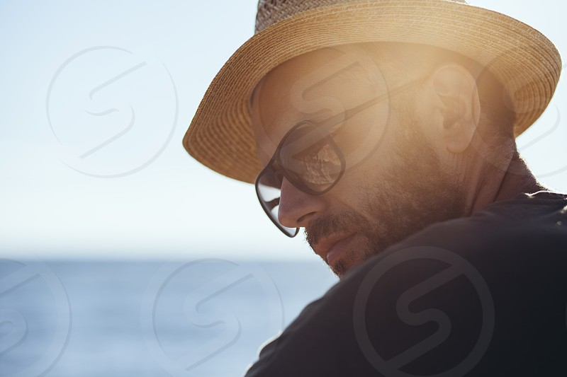 Man enjoying the view in the harbor photo