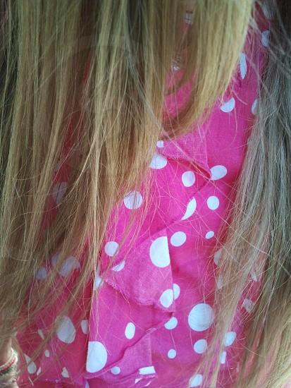 women in pink polka dot shirt photo