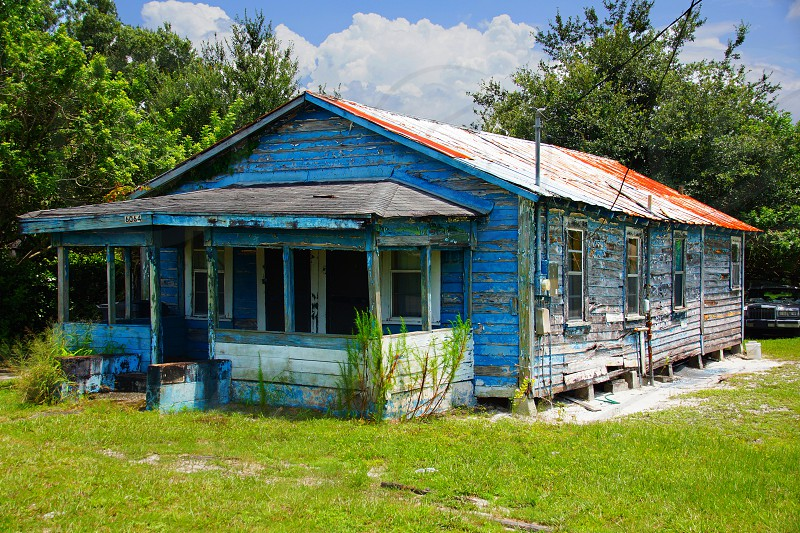 blue wooden bungalow surrounded by trees during day photo