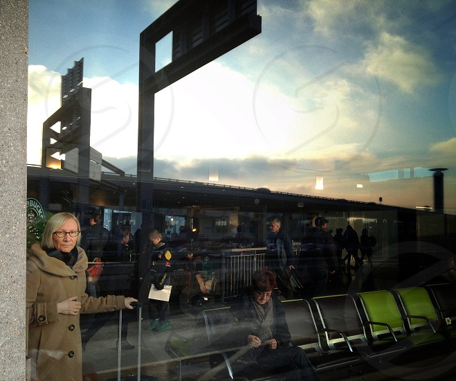 woman in brown coat near wall photo