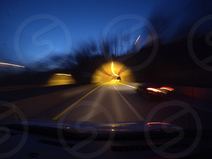 Entering a tunnel at night on I-64 near Louisville Kentucky photo