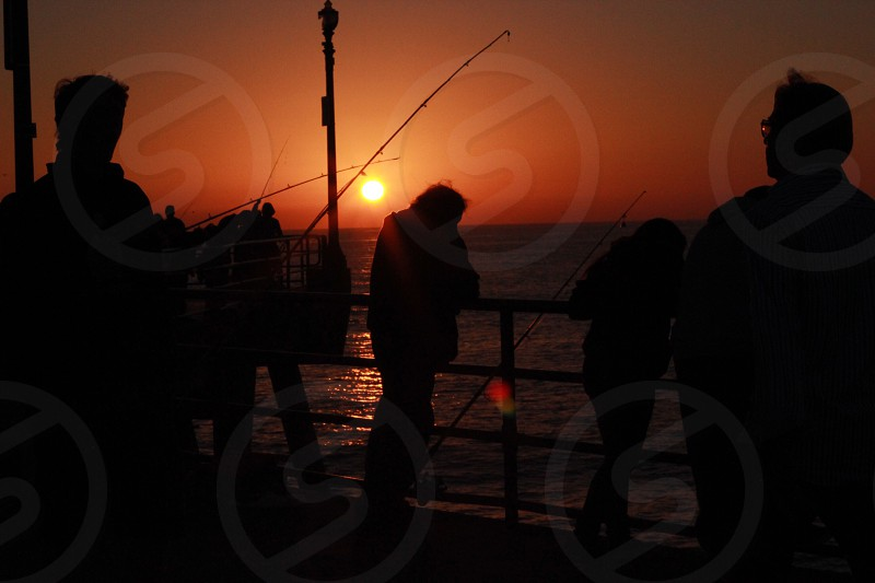 Fishing in the sunset photo