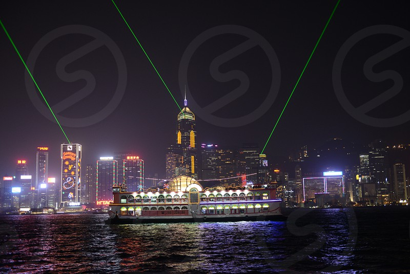 Hong Kong Harbour with pleasure sightseeing boat and light show.   photo
