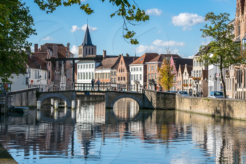 View along a canal in Bruges West Flanders in Belgium photo