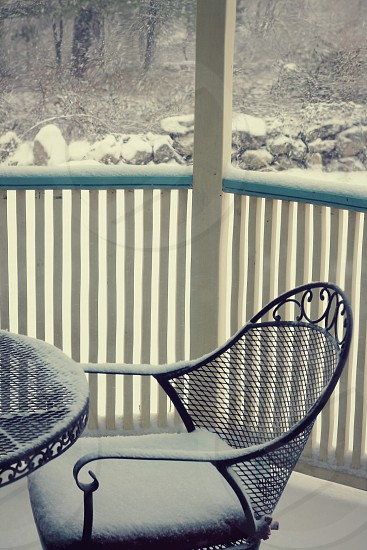 Vintage porch on antique house in winter snow. photo