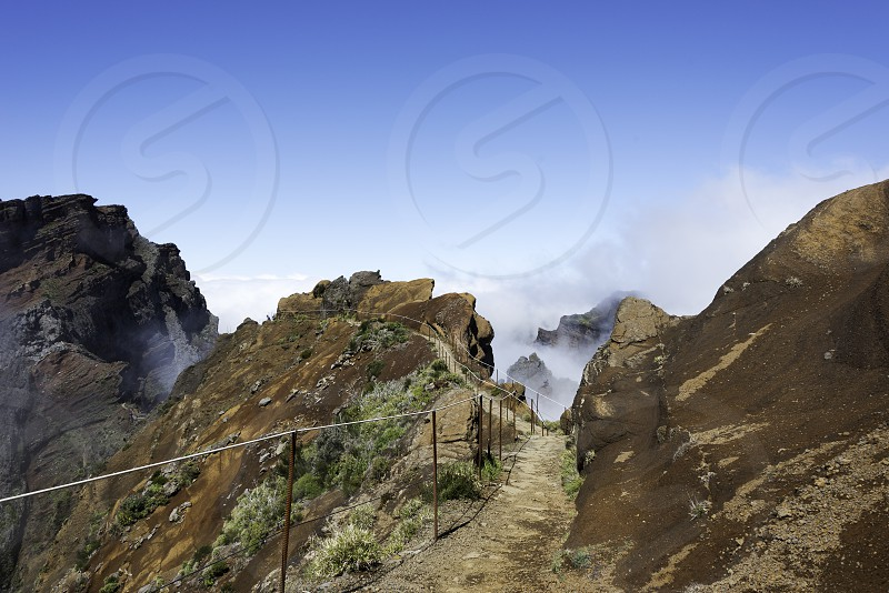 blue sky and brown rocks at the high mountains at madeira island called pico arieiro the top is 1818 meters above sea level photo