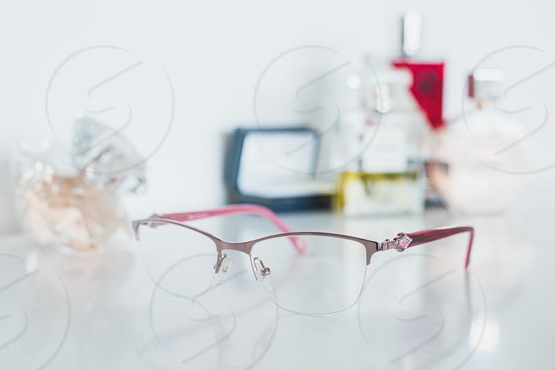 Women glasses and cosmetics photo