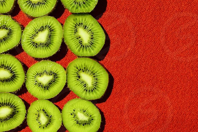 Kiwi fruit red background photo