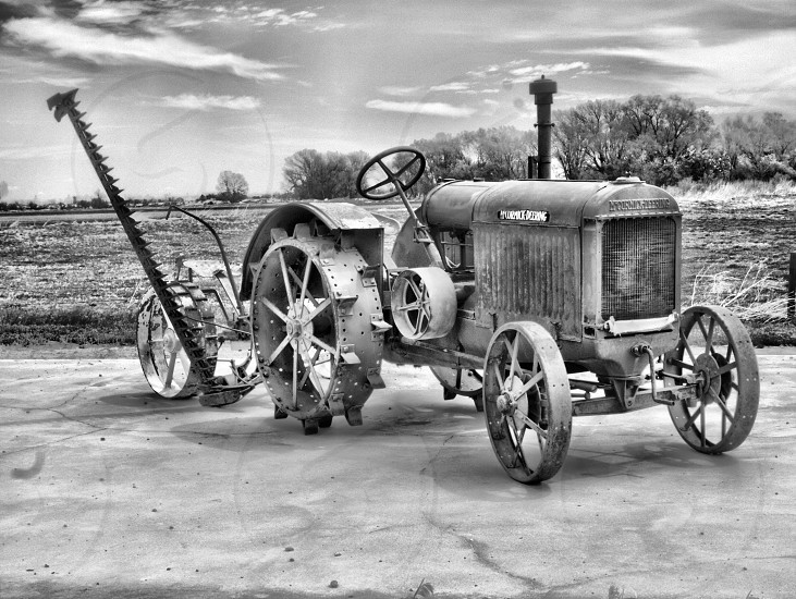 grayscale photography of tractor at the fields photo