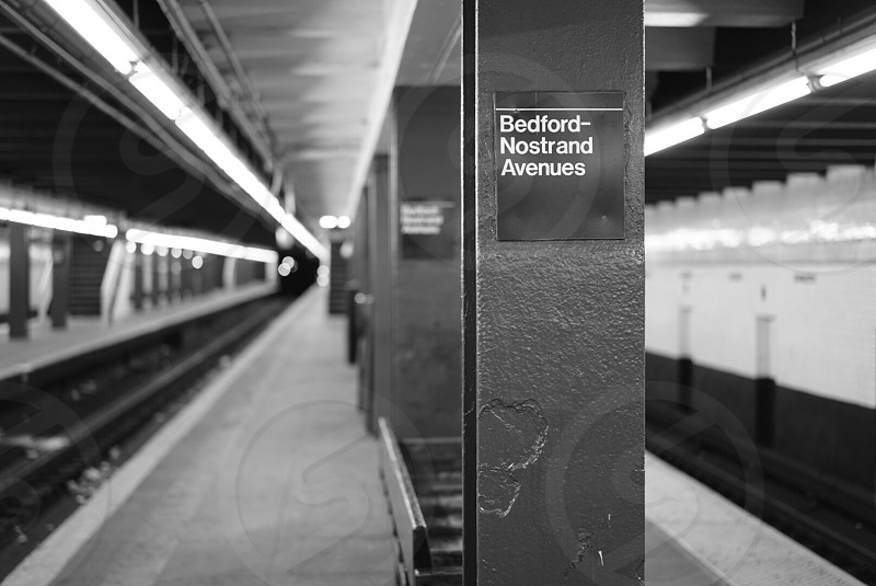 grayscale photo of Bedford-Nostrand Avenues subway photo