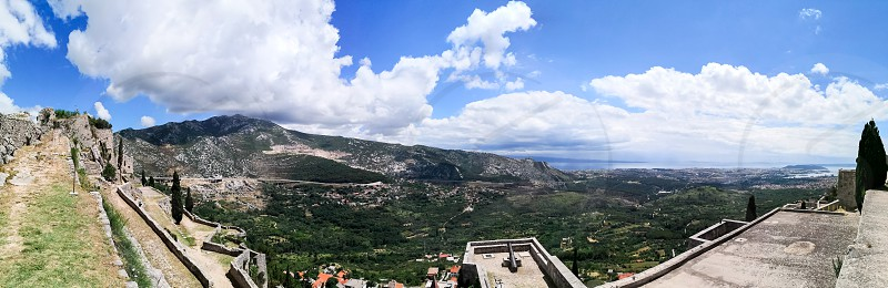 a view of the old village in the horizon and the croatian flag from the klis fortress photo
