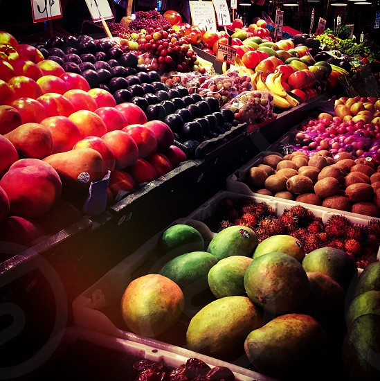 Indoor day colour square landscape horizontal grocer greengrocer fruit vegetables dates mangoes lychees kiwis apples peaches nectarines pears apples plums grapes bananas kumquats nature natural health farming agriculture Pike Place Market Seattle WA Washington State USA United States America North America travel tourism tourist wanderlust photo