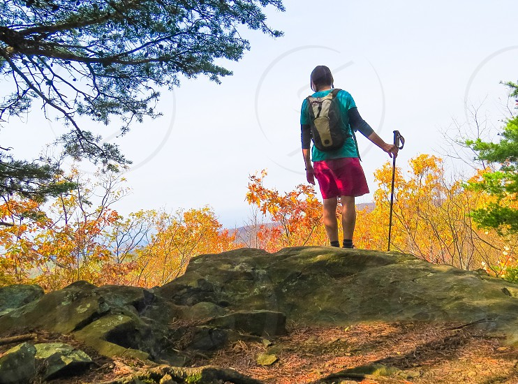 Women hiking strong independent mountains  photo