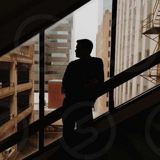 man standing near stairs  photo