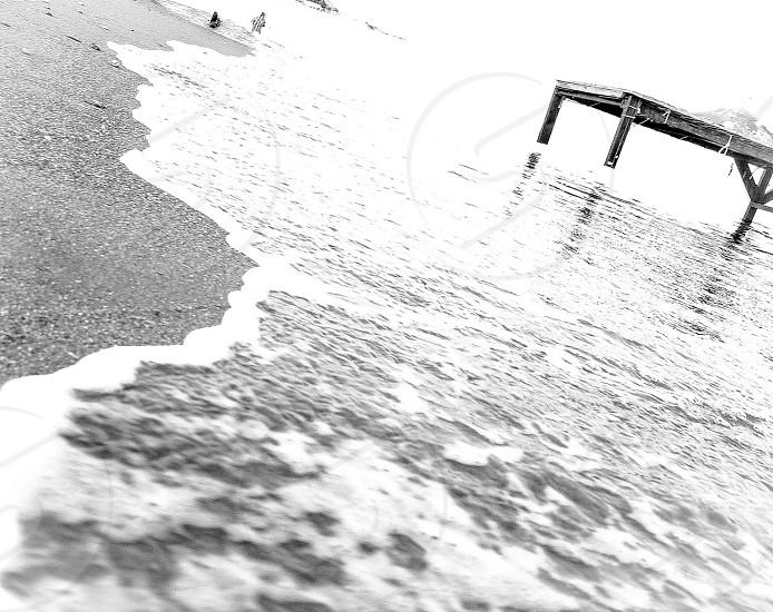 Waves along the shoreline photo