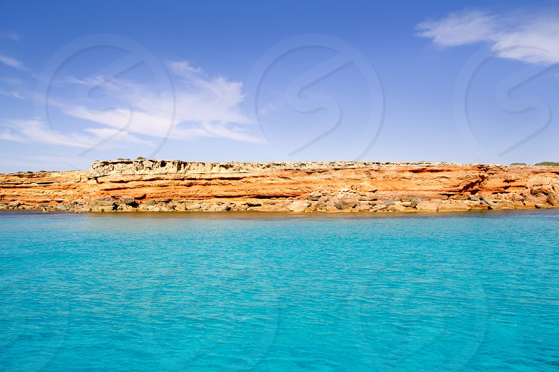 Formentera balearic island view from sea of the west coast with red mountains photo
