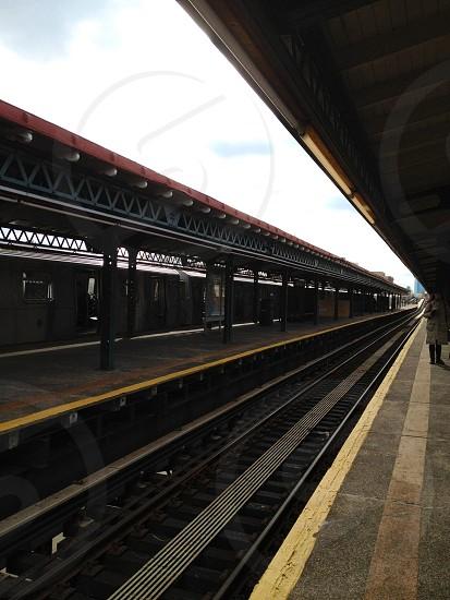 train tracks at a station photo