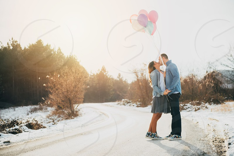Love Air Kiss Balloons Valentine's day Couple Girl Boy Man Woman Engagement Road Sunshine Road Sunny Sunset Flare Trees Yellow Color photo