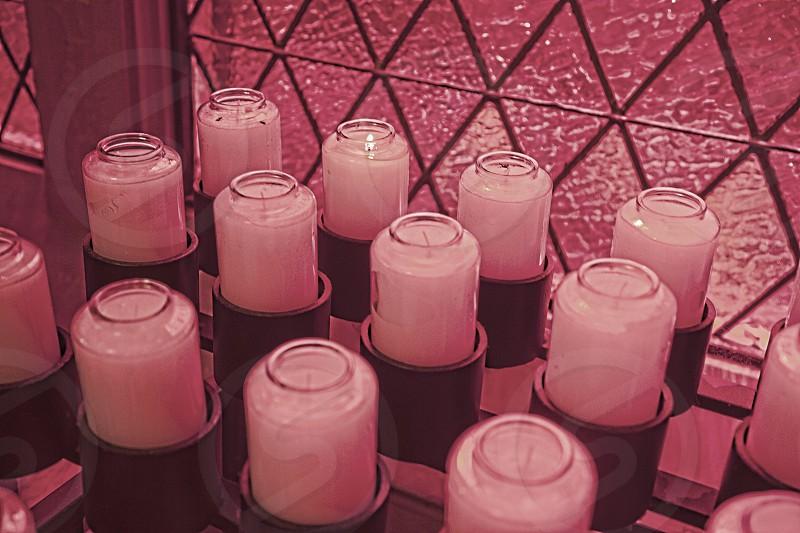Prayer candles inside a church photo