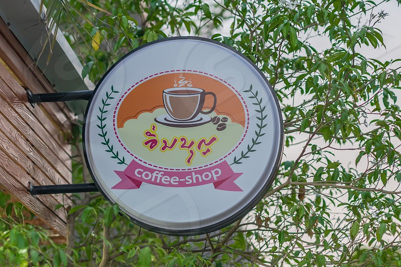 A coffee shop sign in Thailand. photo