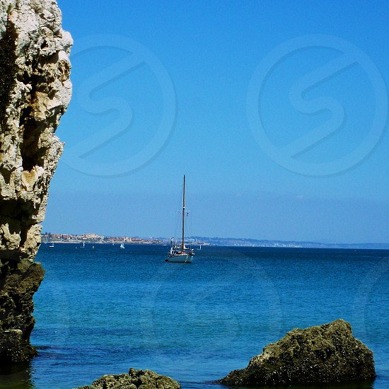 white sailing boat on water photo